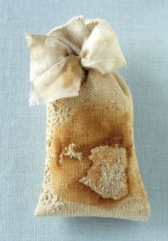 """Sachet, approx. 6""""x3"""". Rust-printed linen, hand-dyed wool, eco-dyed silk tie, organic lavender. 2012 photo credit: Tyllie Barbosa"""