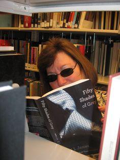 Robin reading Fifty Shades of Grey