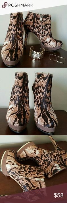 🎉Price Drop🎉Vince Camuto Leopard Booties Amazing animal print stiletto booties trimmed in gold! These are in excellent shape. Outside is covered in fur  and platform rimmed in gold. These look like they were hardly worn. Near perfect condition. I'm sad to let these go but again, they are a reposh as they are just too high. Selling price is what I purchased them for. *earrings and bracelet not included* Vince Camuto Shoes Platforms