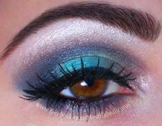 Smokey Blue Shadow. most babealicious makeup. cat eye, winged liner. brown eyes. bfte cosmetics and madd style cosmetics