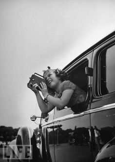 Shirley Temple - The 9-year-old box office titan and future diplomat takes pictures of Washington, D.C. landmarks during a 1937 visit to the nation's capital.