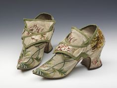 © Victoria and Albert Museum, London. 1730s-1740s. Given by Col. F. G. G. Bailey. This pair of women's shoes is made up of a brocaded silk woven in Spitalfields, London. Indoor shoes for women were usually made of patterned silk although it was very rare for them to match the fabric of the gown worn with them. The shoes have a fashionable pointed toe, a medium stocky heel and latchets that would have been fastened with buckles. ...