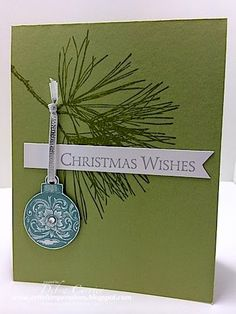Stampin' Up! ... handmade Christmas card from ARTfelt Impressions ... clean and simple makes for an elegant look ... olive background stamped with pine bough ... round ornament hanging on silver ribbon ... luv it!