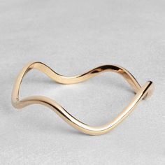 OTHER STORIES -SCULPTED WAVE BANGLE -THE SHAPE OF THE SEASON