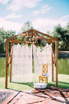 bohemian ceremony altar - photo by Cara Robbins Photography http://ruffledblog.com/floral-inspired-treehouse-wedding