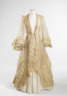 American cotton evening dress, originally made and worn as a bridesmaid dress in 1862, and altered in the early 1870s into its current polonaise style. The delicacy of the organdy and mull and the beautiful execution of the alteration exemplify the owner Amelia Beard's resourcefulness and talent for dressmaking ~ pinned by #Blucha from metmuseum.org ~ for side view see http://www.pinterest.com/pin/136656169918933749/