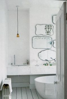 When you can't afford a big mirrored wall (or say, if you're renting an apartment) this is a neat trick - lots of second-hand, vintage mirrors.
