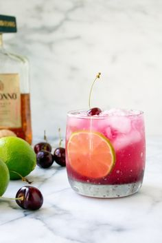 Fresh Cherry Amaretto Margaritas | These are amazing for a few reasons (1) they're really easy and only take about 5 minutes to put together (no simple syrup making required!), (2) fresh cherries, (3) amaretto, and (4) FRESH CHERRIES. @yestoyolks
