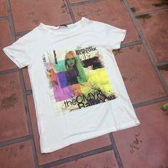Soft and Stretchy Tee from Brazil This unique shirt has no clearly marked size, but could work for many.  A size small could wear this with leggings and a larger size would have a more fitted look. Could probably fit up to a L because of the stretch. It is oh-so-soft and never worn. The design is a fabric overlay on the top and not just a screen print. Brazilian Tops