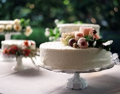 simple white cake with flowers..love the idea of having several small cakes..using different cake stands