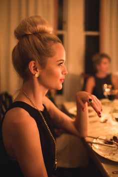 Chignon and black coctail dress and ring- perfection!
