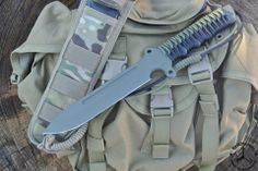DSK TACTICAL SAND SHARK  $359.99  PRODUCT DESCRIPTION 1/4 inch steel, coated with Para-cord wrapped handle and Spec-Ops sheath.  Overall length 13.2 inches, blade length is 6.7 inches.