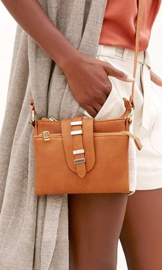 Mini cognac crossbody bag with eight inside card slots and cool gold hardware
