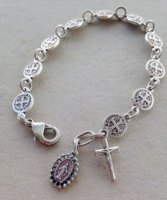 This simple, beautiful bracelet is made with 10 oxidized St. Benedict medals representing one decade of the rosary. Each medal is joined by a