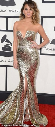Chrissy Teigen was sporting a plunging gold sequinned Johanna Johnson gown at the Grammys