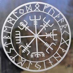 This rune is known as vegvisir, Icelandic for guidepost and sometimes referred to as the Viking Compass. The purpose of this magical charm is to help guide ones way without getting lost. This is surrounded by all 24 characters of the Elder Futhark. This decal measures 5 inches (12.7 cm)