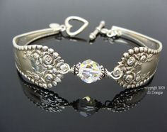 I totally want to figure out how to make a spoon bracelet with some of my mother's old silverware.  Gorgeous!