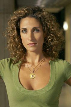 Melina Kanakaredes - seriously love her. Miss her on CSI: NY.