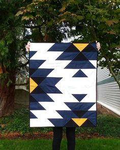 This patchwork quilt was inspired by native american indian art and crafts. It is made from 100% cotton fabric and lightweight cotton batting. The colors in this quilt are dark blue, black, yellow and white. The backing part is gray. There are two available sizes:  Small (Baby Size): 34 x 42 inches/ 86 x 107 cm  Large (Full Size): 72 x 88 inches/ 182 x 224 cm  The binding is hand stitched to the back in the traditional style.  Production time for standard order is 3-6 business days for small…