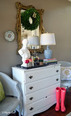 Create an organized and elegant front entryway or foyer using colorful throw pillows, a chair or two, a mirror, and a dresser (great for stashing dog leashes, hats/gloves/scarves, and and even your keys).  Adding color is easy with fresh flowers, a pretty lamp, pillows, and other accessories.  {Sponsored by HomeGoods}