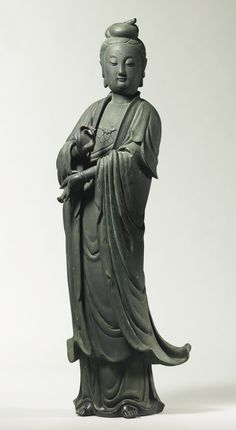 A BRONZE AND SILVER INLAID STANDING FIGURE OF AVALOKITESVARA China, Ming dynasty