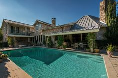 Luxury Real Estate Auction March 14, 2017 - 4.5 acres, stocked semi-private lake, 30 mins from Downtown Dallas, 10,000+ sq. ft, 500 bottle wine cellar, floor to ceiling windows, 200+ year old Heart Pine wood floors, stained glass windows, 2 fitness rooms, heated pool, outdoor kitchen and bar, lighted tennis courts, access to Gleneagles Country Club & Willow Bend Park. | 3420 Ranchero Rd., Plano, TX -- Heritage Auctions (HA.com)