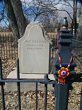 "Kit Carson's Grave, Taos, New Mexico - Soon after his return from Washington, D.C., his wife Josefa died from complications of child birth. Carson died a month later from an abdominal aortic aneurysm at age 58. He was buried next to his wife. His headstone inscription reads: Kit Carson Died May 23, 1868 Aged 59 Years His last words were: ""Adios Compadres."" Spanish for goodbye friends."