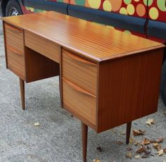 Gorgeous teak desk dating from the 1970s. This desk is a fab size & could also be used as a dressing table.