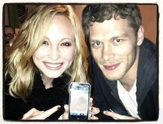 Candice & Joseph. :D What is that picture on the phone?! I need to know.