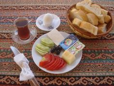 turkish breakfast: cucumbers, tomatoes, cheese, boiled egg, fresh bread, and çay. it was different, the tomatoes and cucumber, but it really is the best idea ever!
