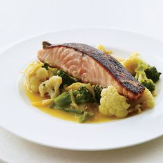 "Salmon with Gingery Vegetables and Turmeric | Alternative-health experts like Dr. Andrew Weil are lauding the ""anti-inflammatory"" diet, claiming that vegetables like broccoli, spices like turmeric and oily fish like salmon can ward off disease. This dish by F&W's Marcia Kiesel should make Dr. Weil very happy."
