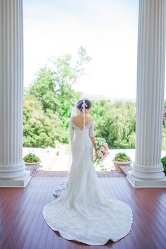 Bride in a Stunning Custom Wedding Dress and Cathedral Veil | Elegance By Roya | Sponseller's Flower Shop Inc. | Taylor and Ben Photography https://www.theknot.com/marketplace/taylor-and-ben-photography-falls-church-va-872345