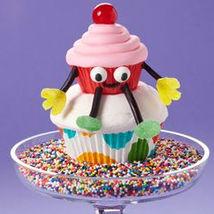 Guests will sit up and take notice of these fun combo cupcakes! A cute mini character is sitting pretty on a standard iced cupcake, adding personality to any party.