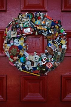 Wreath made of flotsam & jetsam from junk drawers by tarnished edges