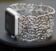 This 38mm / 42mm Apple Watch Band is made of small silver pieces with an intricate filigree design. It is delicate and neutral and perfect for everyday wear.