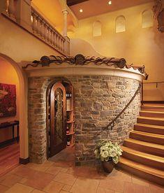 Veneto Fieldledge Wine Cellar by Eldorado Stone. The cellar is architecturally incorporated into the staircase design.