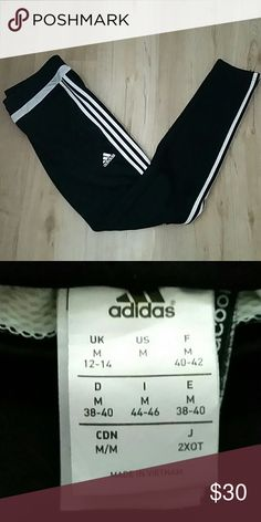 Adidas Team Tiro 15 Training Pants Adidas black running sweatpants with 3 white lines going down the sides. Zippered pockets and tapered ankles. Great condition, lightly used. Getting rid of them because they are too big on me. adidas Pants Track Pants & Joggers