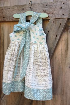 Flower girl dress idea #5-love the French script on the body. Very shabby chic