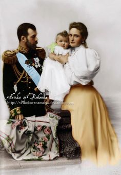 Happy family in 1896.   The last Imperial couple of Russia - Tsar Nicholas II. (1868-1918) and his wife Alexandra (1872-1918) with their eldest child, Grand Duchess Olga (1895-1918)