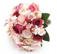 A large posy of deep pinks and cream/pink garden roses with cherry blossom.