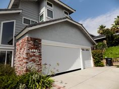 We Installed A Motorized Power Screen On A Garage Door In Laguna Hills California In Orange County For Th Garage Doors Twilight House Traditional Style Homes