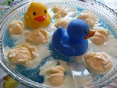 Lucky Duck Punch    1 (0.13 ounce) package berry blue flavored unsweetened Kool-Aid drink mix   1 (2 liter) bottle lemon-lime flavored carbonated beverage   1 (64 fluid ounce) bottle white cranberry juice   8 scoops vanilla ice cream   1 cup white sugar, or to taste   3-5 new, clean mini rubber duckies (dollar store)      In a large punch bowl, stir together the Kool-Aid, lemon-lime soda and white cranberry juice.Taste, and stir in sugar to your liking. Float scoops of ice cream on the…