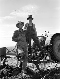 Dust bowl farmer with tractor and young son near Cland, New Mexico, June 1938, by Dorothea Lange