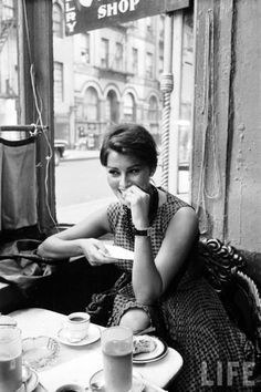 Sophia Loren reading in cafe. Photo by Peter Stackpole, LIFE, June 23, 1958. Peter Stackpole was one of Life Magazine's first staff photographers. He won a George Polk Award in 1954 and taught photography at the Academy of Art University. He also wrote a column in U.S. Camera for fifteen years. He was the son of sculptor Ralph Stackpole.