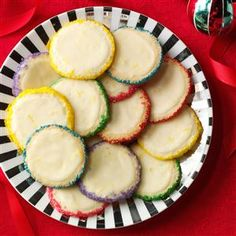 """Slice 'n' Bake Lemon Gems Recipe -Rolled in colorful sprinkles, these melt-in-your-mouth cookies are pretty enough for a party. I make a lot of them for holiday cookie trays. (Complete your cookie tray with <a href=""""http://www.tasteofhome.com/Recipes/Chocolate-Pretzel-Rings"""">Chocolate Pretzel Rings</a>.) —Delores Edgecomb, Atlanta, New York"""
