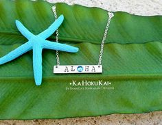 This local Oahu business makes earrings and jewelry perfect for beach weddings!  Aloha Stamped Bar Necklace Swarovski by shandahawaiiandesign, $35.00