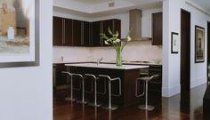 Modern kitchen in black and white with metallic bar stool designed Jennifer Post Design