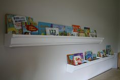gutter bookshelves in the kids play room -  Yes, those are rain gutters ...
