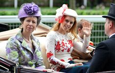 Princess Anne, wearing the same suit she wore for Kate and William's wedding last year, travelled with Princess Beatrice in the carriage behind the Queen and Prince Philip at Royal Ascot, Day 3, 6-21-12.