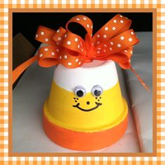 Candy Corn Clay Pot Gift.  This was made for my sons teacher. I had a bow made for the top and used a pipe cleaner to attach by wrapping the pipe cleaner around the bow, putting the ends through the hole on top and making twisting them inside to pot into a spiral.